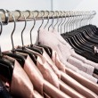 Stock Photo: Clothes on hangers at shop