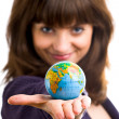 Beautiful woman holds the globe in hand. — Stock Photo