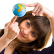 Stock Photo: Young womholds globe in hand.