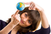 Young woman holds the globe in hand. — Stock Photo