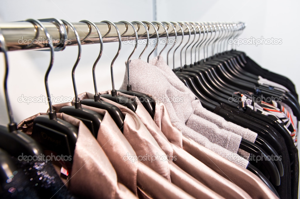 Woman clothes on hangers at a shop — Stock Photo #2759347