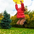 Stock Photo: Girl jumps with umbrella