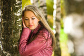 Portrait beautiful young woman with birc — Stock Photo