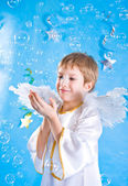 Child in a fairy costume with angel wing — Stock Photo