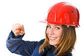 Young woman builder in orange helmet — Stock Photo