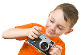 Pretty boy shooting with camera over white — Stock Photo
