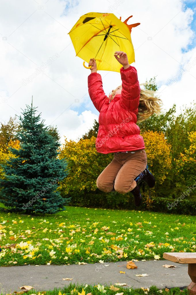 Girl jumps under umbrella in park — Stock Photo #2831358