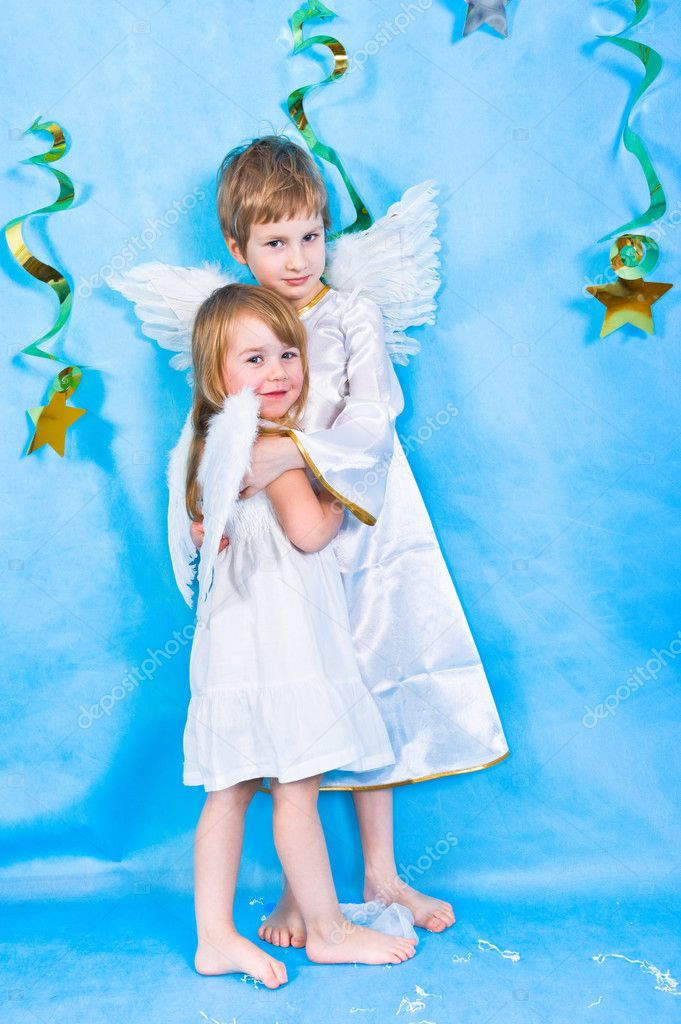 Boy and girl in a costumes with angel wings  — Stock Photo #2832497