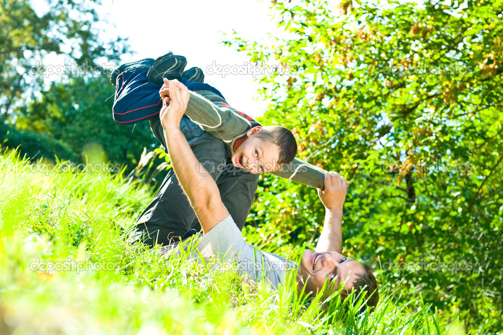 Happy father and son playing outside — Stock Photo #3496863