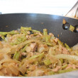 Wok with vegetables and tuna fish - Stock Photo