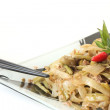 Asian style dish with chopsticks - Stock Photo