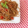 Pasta with vegetables and basil - Stock Photo