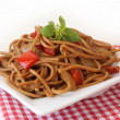Fried noodles with vegetables and basil - Stock Photo
