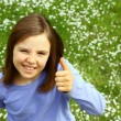 Cute girl with thumb up — Stock Photo