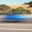Blue vehicle passing by on highway — Foto Stock #3386193