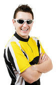 Smiling man in t-shirt wearing sunglasses — Stock Photo