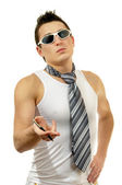 Portrait of attractive muscular man holding pen with tie in sunglasses — Stock Photo