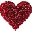 Heart shaped pomegranate seeds, high key — Stock Photo #3614994