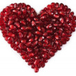 Heart shaped pomegranate seeds, high key — Stock Photo