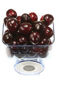 Kitchen scales and cherries. — Stock Photo