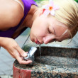 Girl drinking water from fountain — Stock Photo