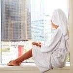 Pretty female sitting by a window — Stock Photo #2804507