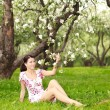 Woman with flowering tree — Stock Photo