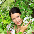 Woman with flowering tree — Stock Photo #3095206
