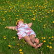 Beautiful girl lying down of grass — Stock Photo