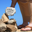 Stock Photo: Mholding rock bible verse John 8:7