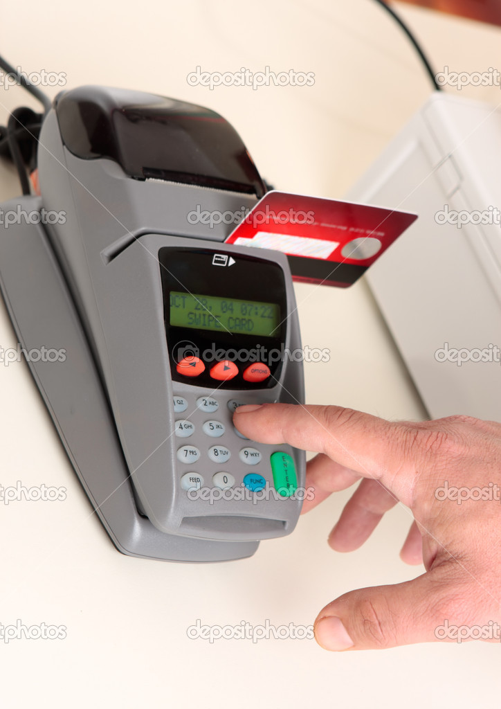 A retailer, salesman or customer using an eft pos machine to make a transaction payment.  Focus to hand and machine only. — Stock Photo #2785576