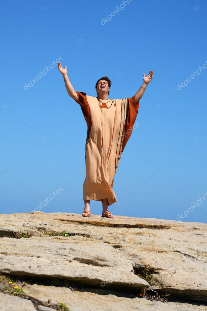Man with arms raised to the sky in worship  Stock Photo #2785783