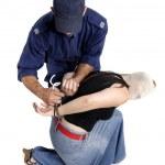 Постер, плакат: Arresting a criminal