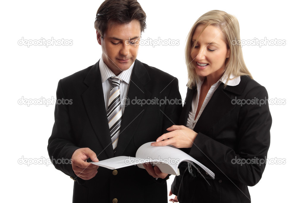 Two work colleagues discuss a report, journal, tender, etc. — Stock Photo #2798289