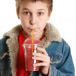 Child drinking fresh fruit juice — Stock Photo
