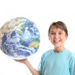 Smiling boy earth ball in palm of hands — Stock Photo