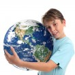 Stock Photo: Love and care for world planet earth