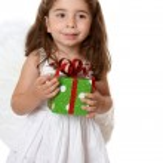 Little angel girl holding a gift — Stock Photo