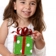 Angelic girl holding a gift — Stock Photo