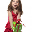 Happy girl holding gift — Stock Photo