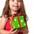 Excited girl holding a present — Stock Photo