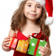 Little girl holding Christmas Presents — Stock Photo #2808354