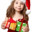 Little girl holding Christmas Presents - Stock Photo