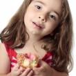 Smiling girl eating snack pink donut — Stock Photo