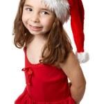 Smiling girl in red santa hat — Stock Photo