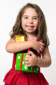 Happy girl child holding presents — Stock Photo