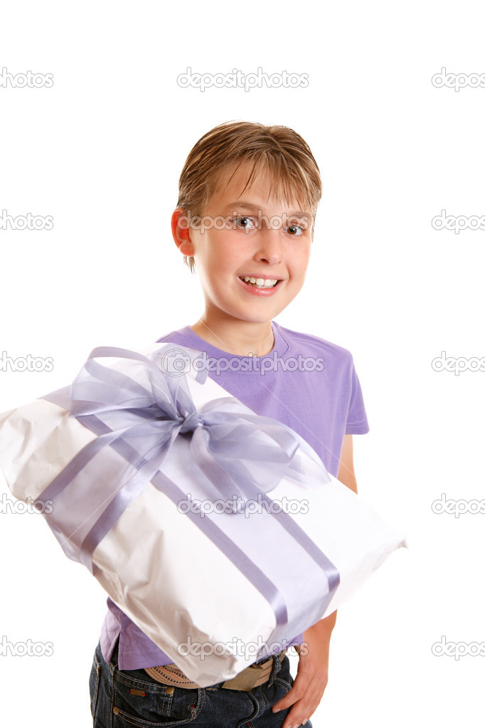 A boy holds a wrapped present tied up with gauze and satin purple ribbon. — Stock Photo #2800057