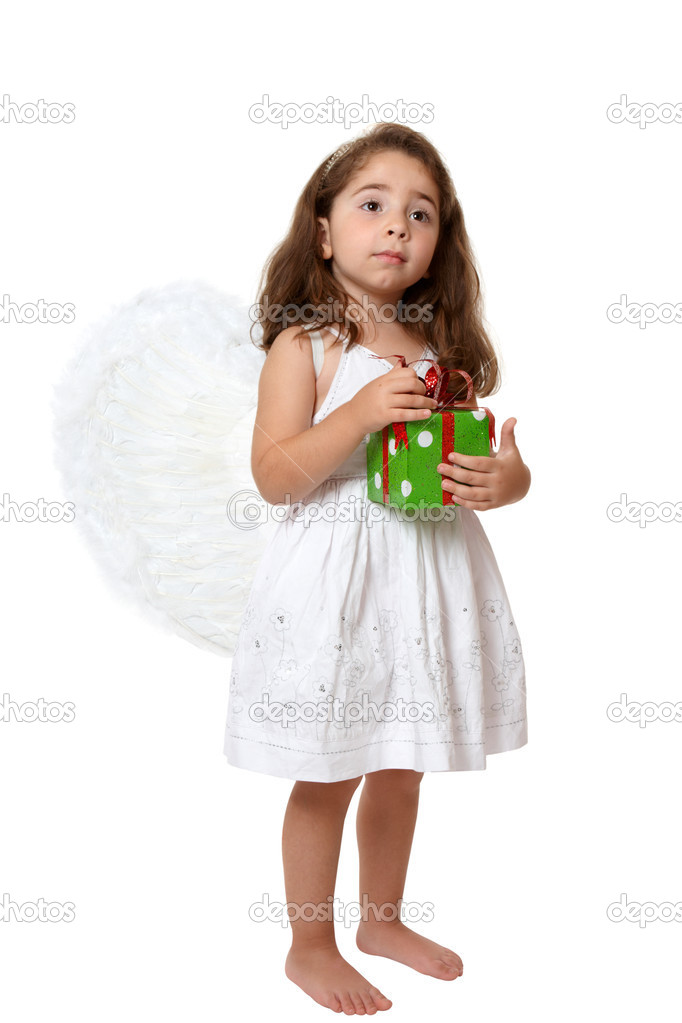 Angel girl wearing white embroidered dress and feathered wings is holding a red and green Christmas or brithday  present. — Stock Photo #2807945