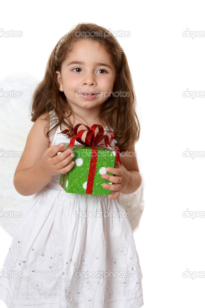 Beautiful little girl wearing a white dress and wings is holding a present. — Stock Photo #2807970
