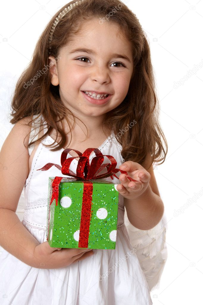 Pretty little girl holding a present and smiling.    — Stock Photo #2807994